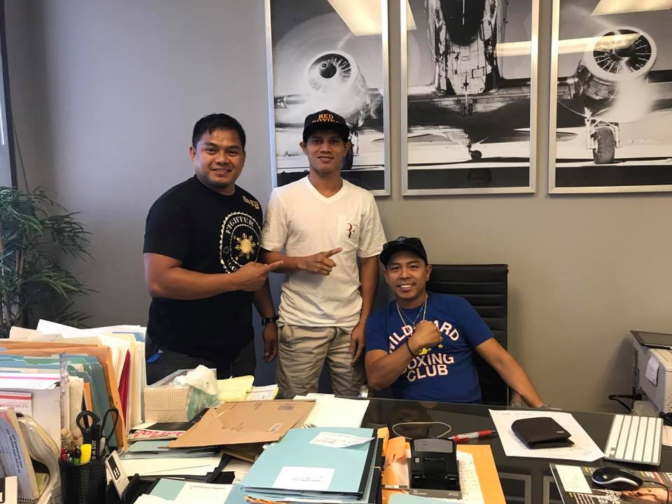 """7d97c94b09 Recky """"The Terror"""" Dulay (middle) with new manager Rey """"Cacoi"""" Rodis Jr.  (right) and assistant trainer Stanley Godinez."""