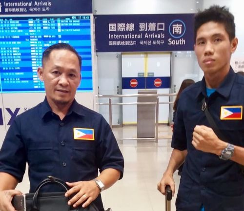 Noynay and coach Artcher Villamor Arrive in Osaka