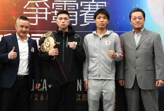 WBA Champion Xu Can and Japanese challenger Shun Kubo with their handlers pose during presser